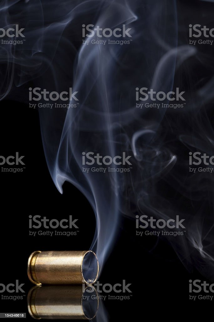 Smoking bullet casing stock photo