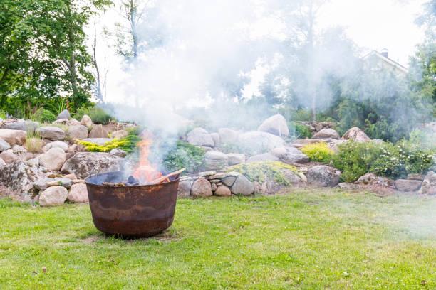 Smoking cauldron in a garden in summer stock photo