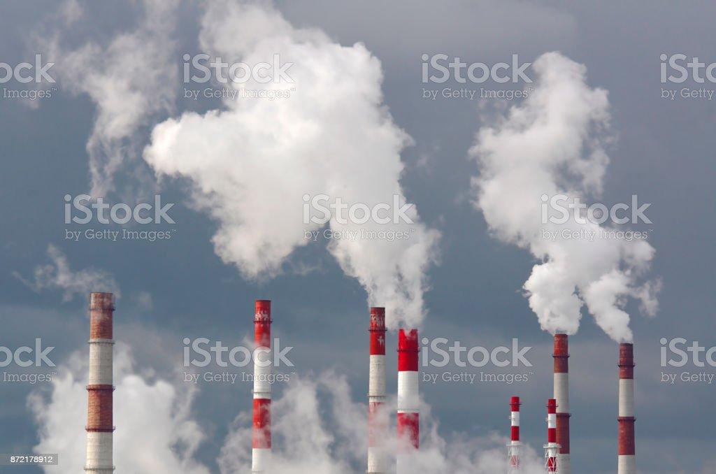 Smoking chimneys against the sky stock photo