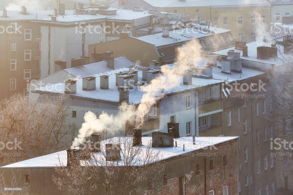 Smoking chimneys in Szczecin city residential district, Poland. stock photo