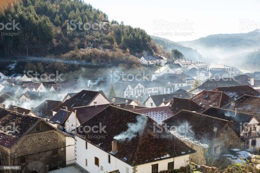 Smoking chimneys in the village of Ochagavia stock photo