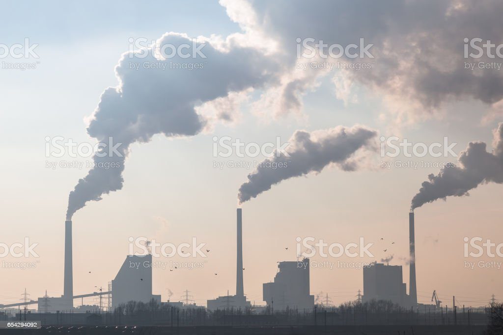 Smoking Chimneys of a Coal Fired Power Plant stock photo