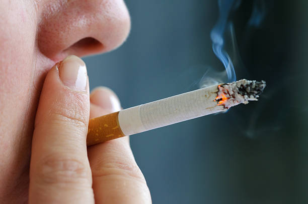 Smoking cigarette Smoking cigarette smoke physical structure stock pictures, royalty-free photos & images