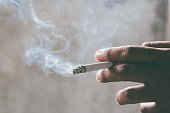 istock smoking Cigarettes tobacco in hand with a soft-focus. concept quit Cigarettes are dangerous to health. 951149066