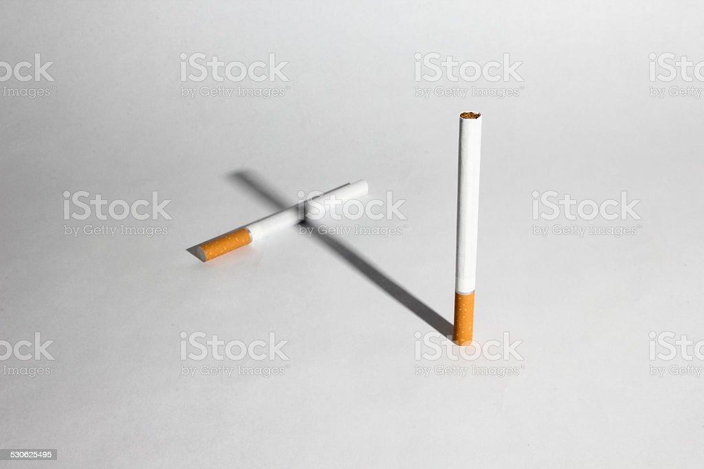 Smoking cross stock photo