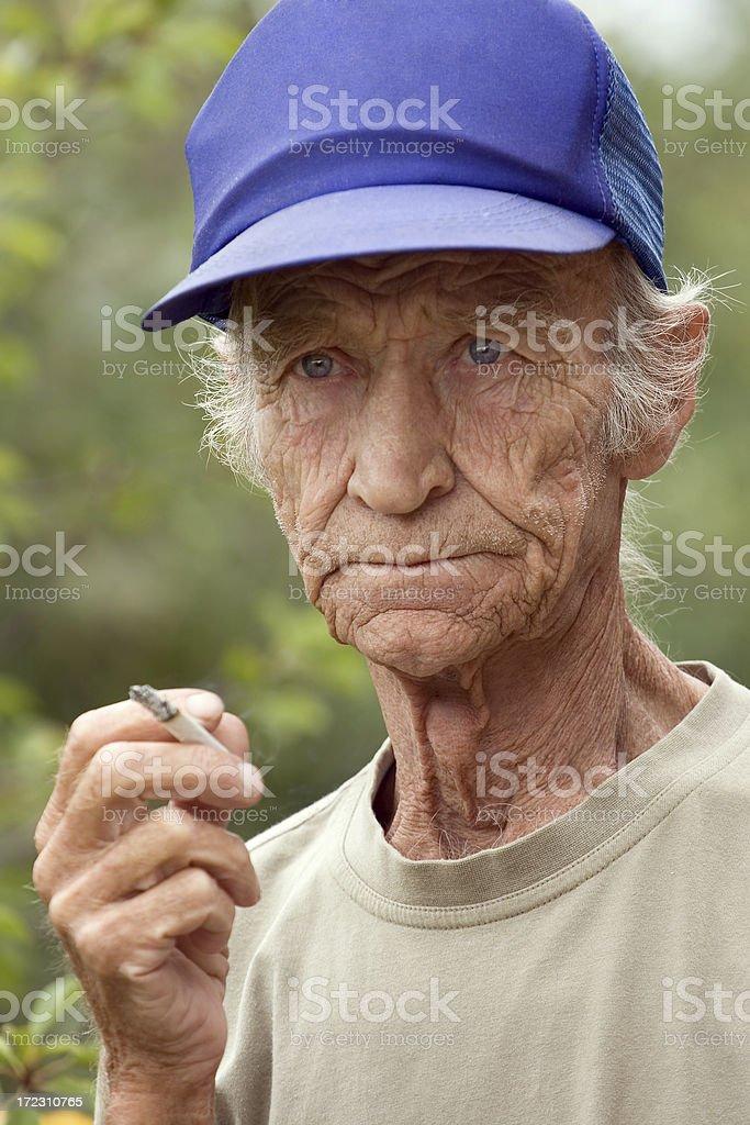 Smoking elderly the man royalty-free stock photo