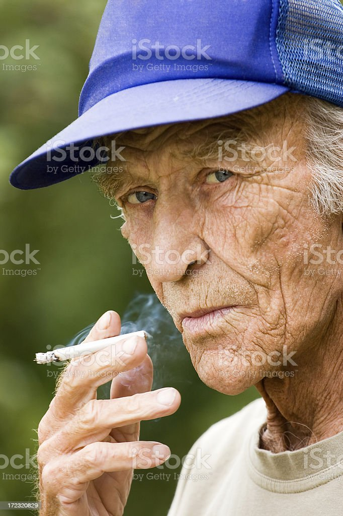 Smoking elderly the man royalty-free stock photo