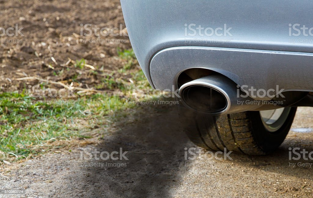 Smoking exhaust pipe stock photo