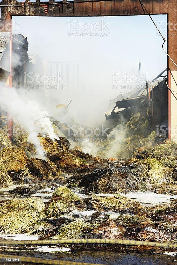 Smoking Fire Burning Hay Barn stock photo