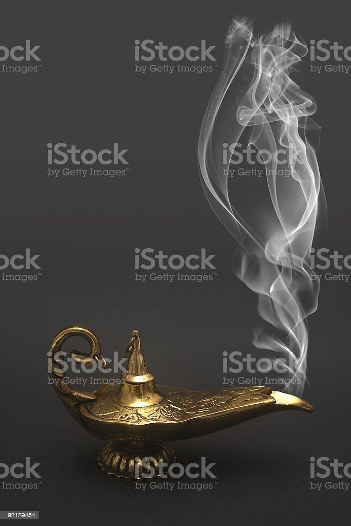 Smoking genie lamp with shiny exterior stock photo