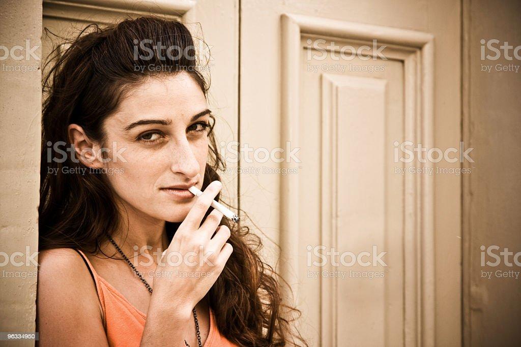Smoking girl Looking at Camera Seriously royalty-free stock photo