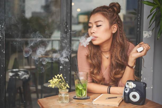 Smoking girl stock photo