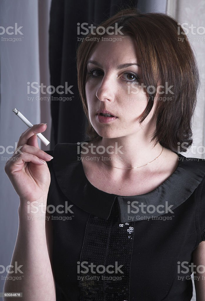Smoking girl royalty-free stock photo