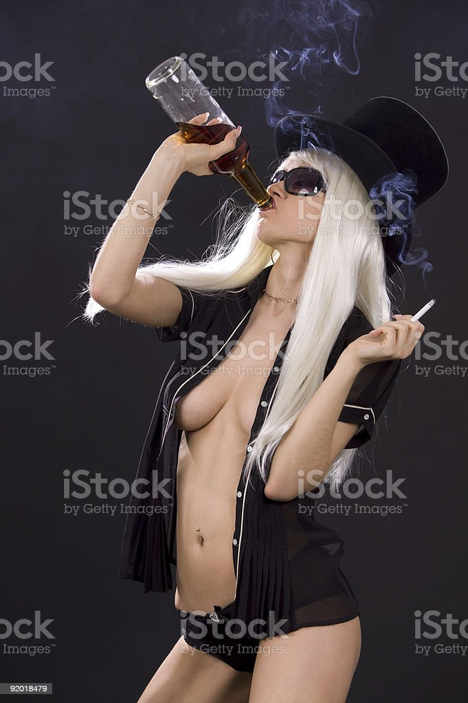 smoking girl with bottle of whiskey royalty-free stock photo
