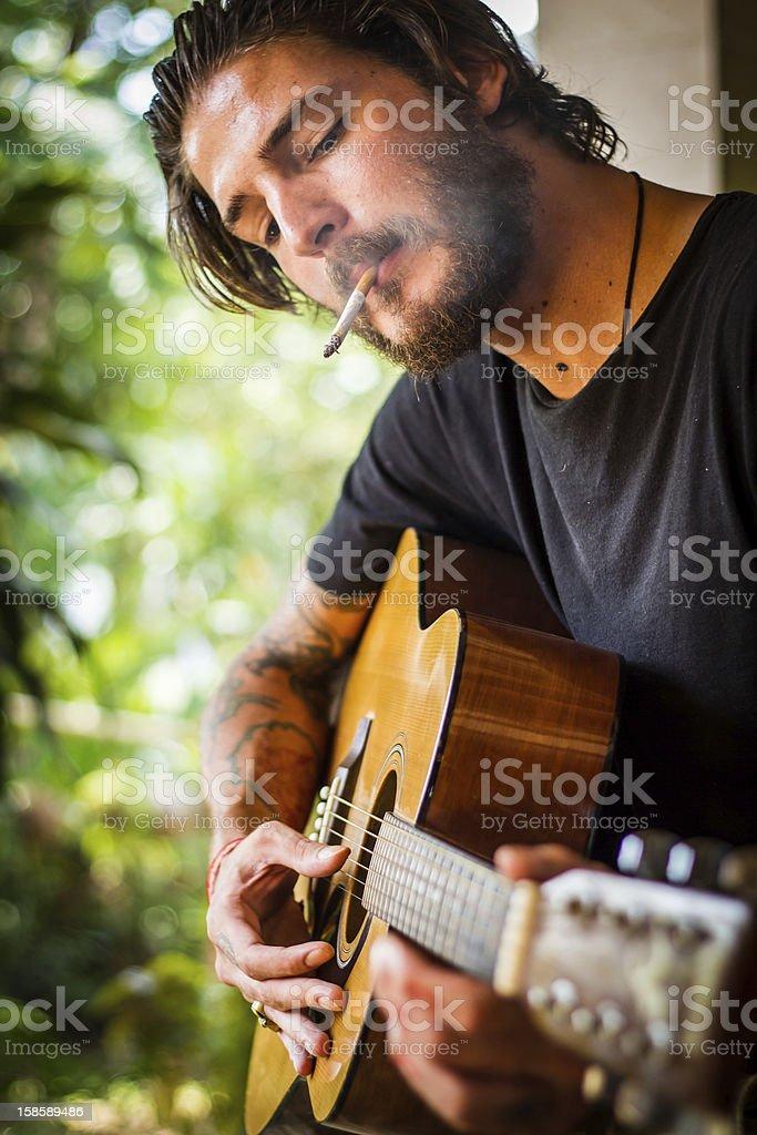 smoking guitar player stock photo