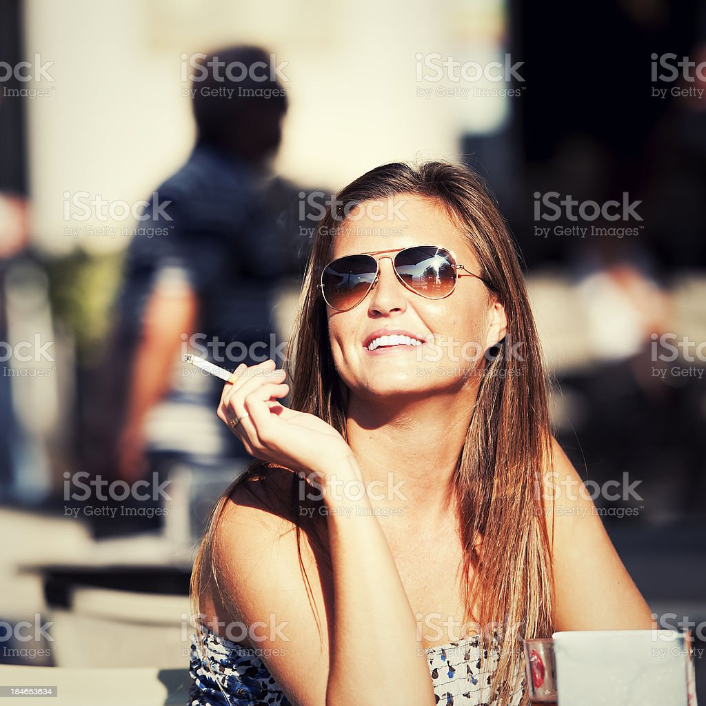 Smoking in the eving sun royalty-free stock photo