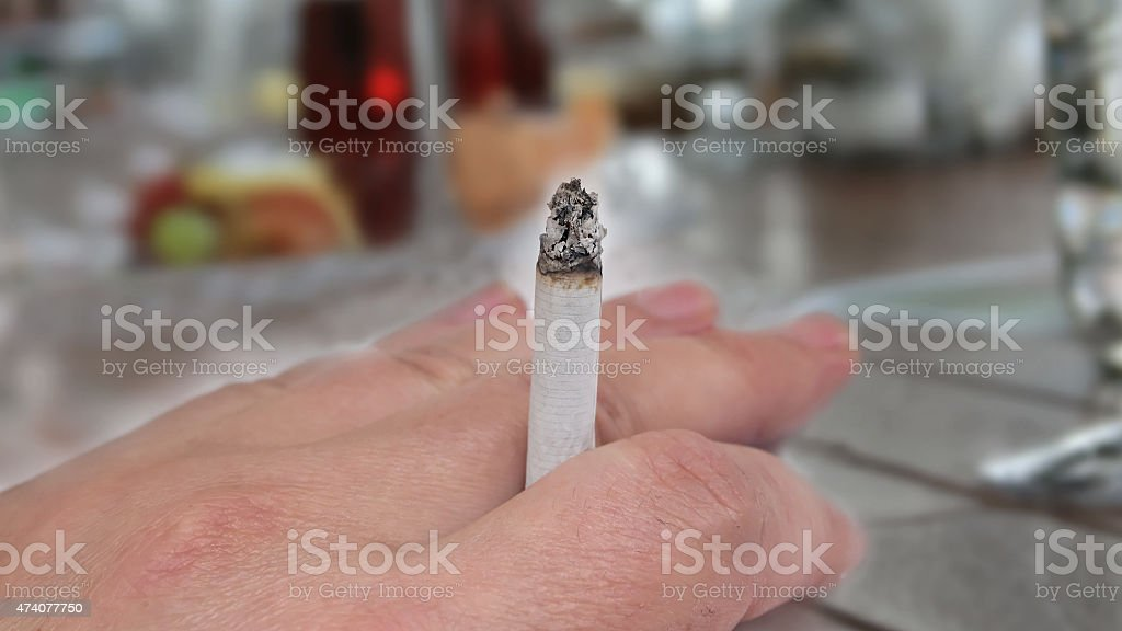 Smoking in the restaurant stock photo