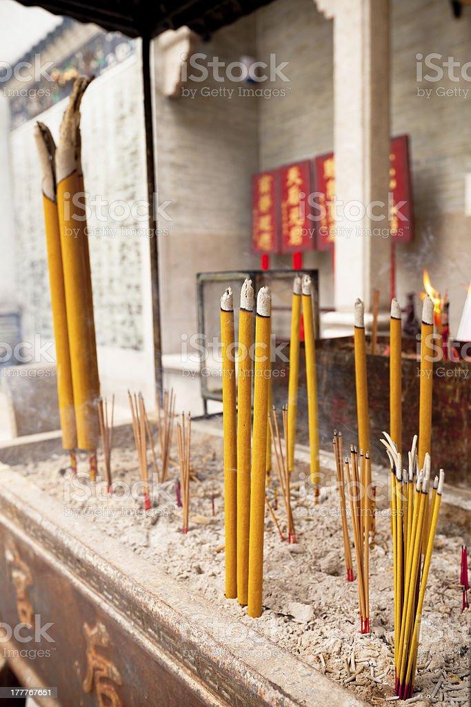 Smoking Incense Sticks at a Temple in Hong Kong royalty-free stock photo
