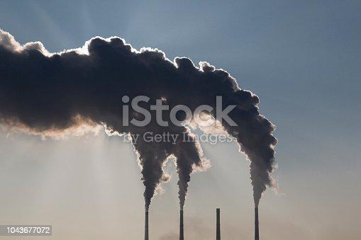 istock Smoking industrial chimneys 1043677072
