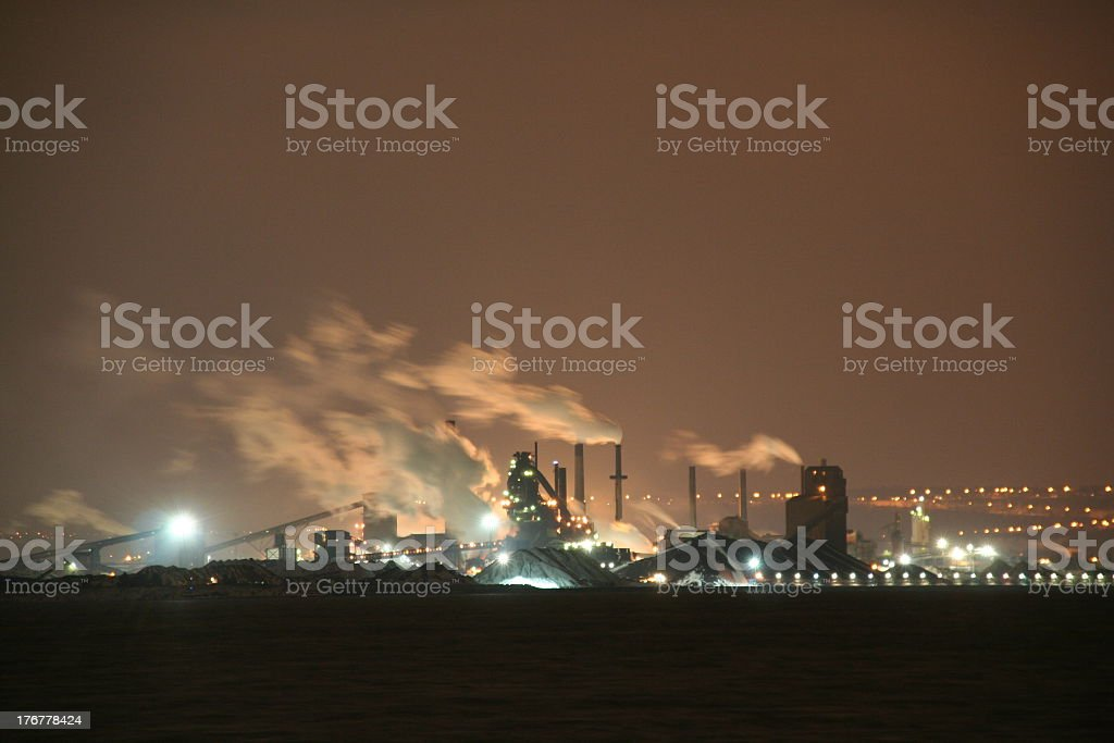 Smoking Industrial park at night royalty-free stock photo