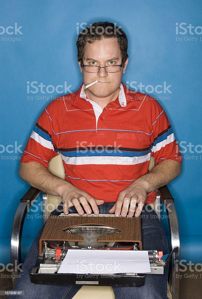 Smoking journalist with typewriter royalty-free stock photo