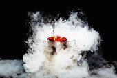 Smoking lobster in boiling pan