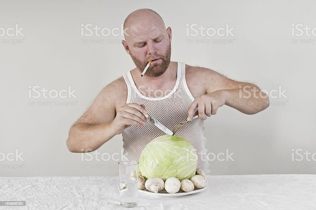 Smoking man eat cabbage and mushrooms royalty-free stock photo