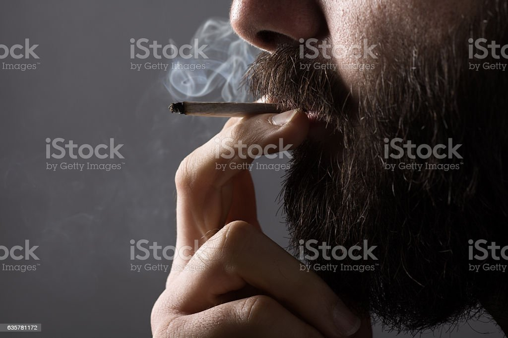 Smoking Man stock photo