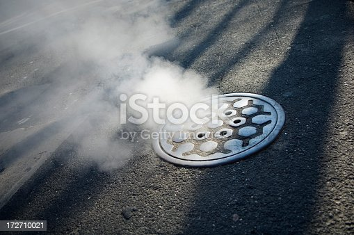 Urban Scene of a smoking manhole cover in Manhattan
