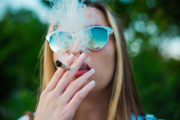 Smoking marijuana Smoking marijuana smoking issues stock pictures, royalty-free photos & images