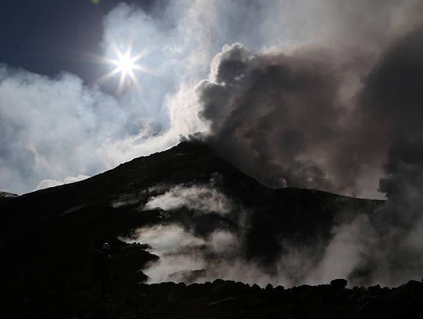 Smoking Mount Etna volcano stock photo