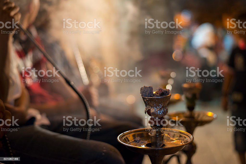 Smoking nargila in Jerusalem's Muslim Quarter stock photo