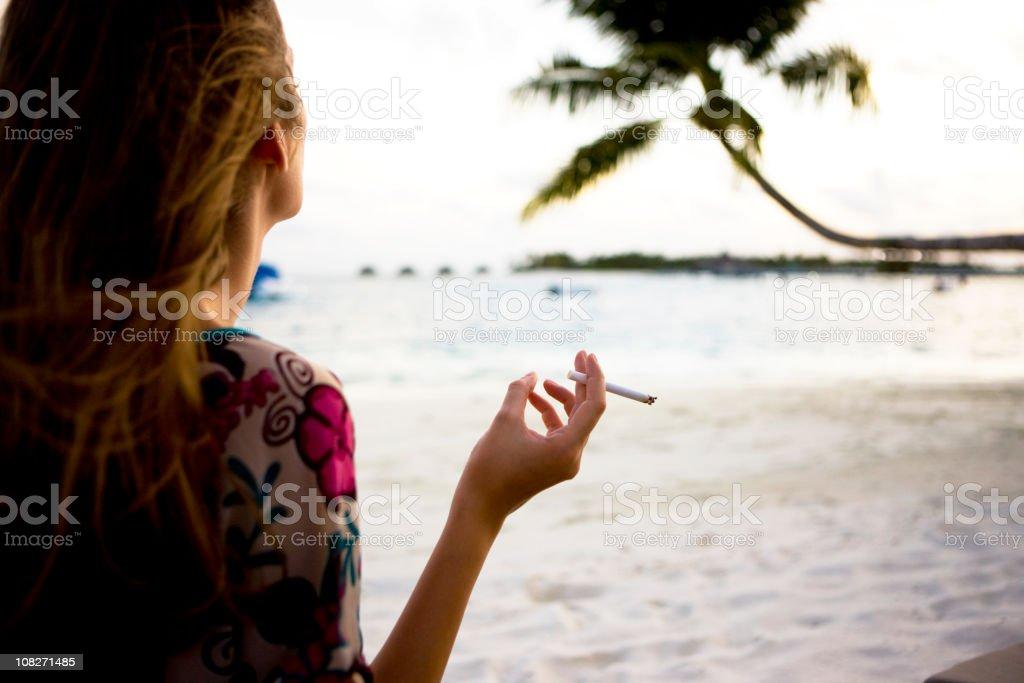 Das Rauchen ist am Strand – Foto