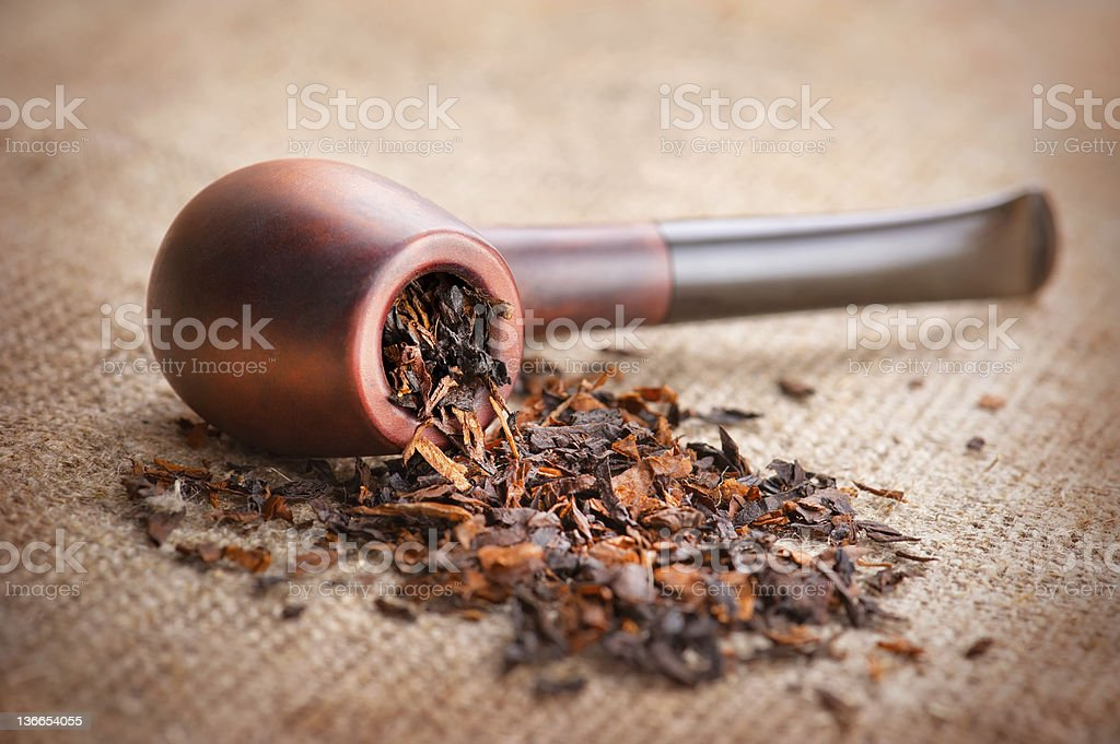 Smoking pipe and tobacco stock photo