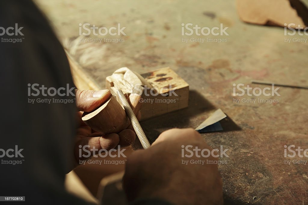 Smoking pipe being processed with file tool stock photo