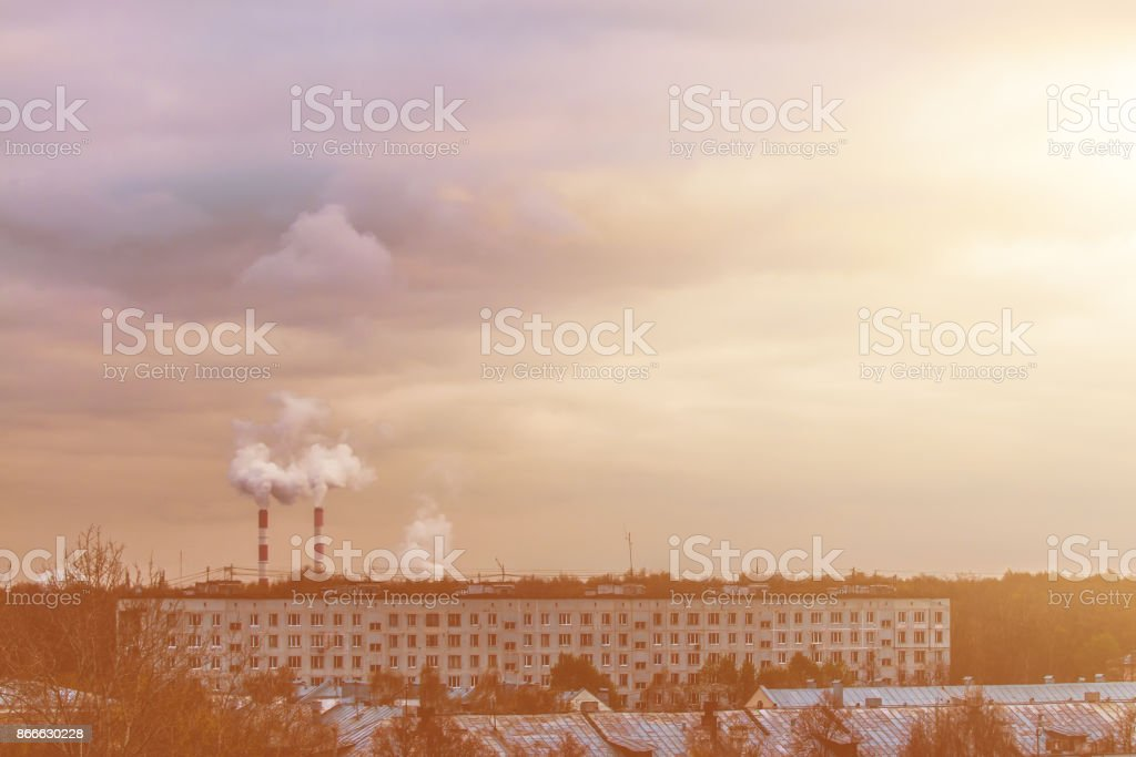Smoking pipes of thermal power plant on sunset stock photo