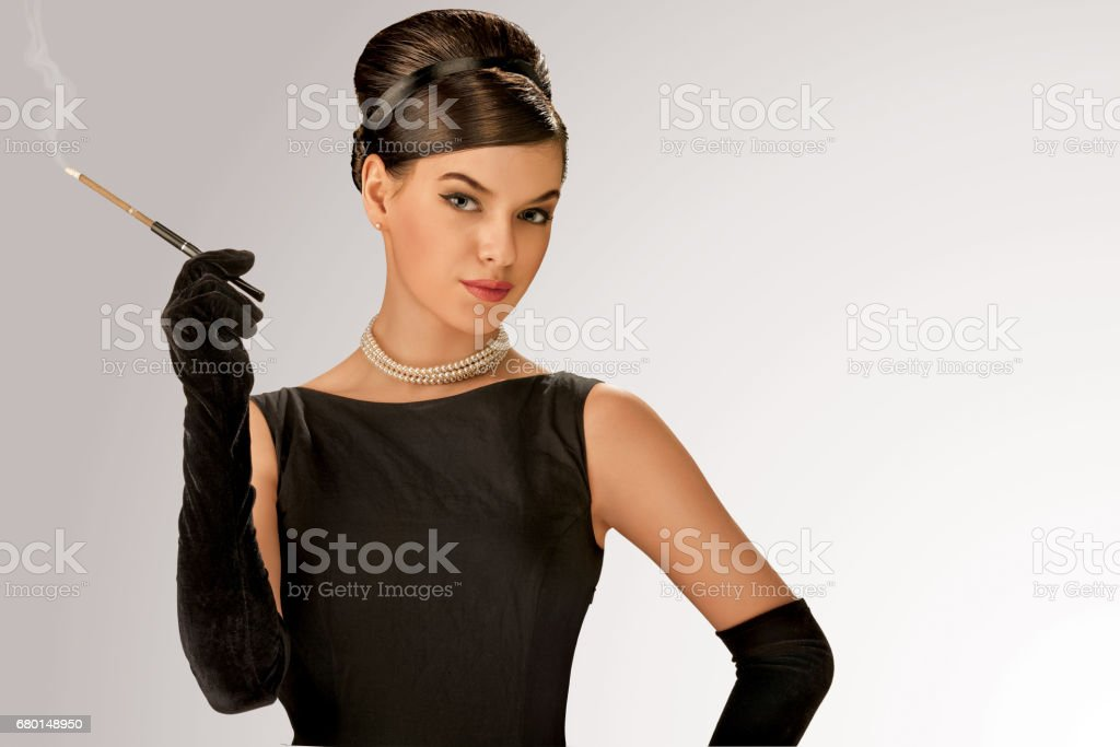 Smoking retro girl. stock photo