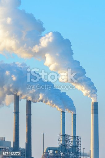 istock Smoking rising up from an coal energy power plant 677442272