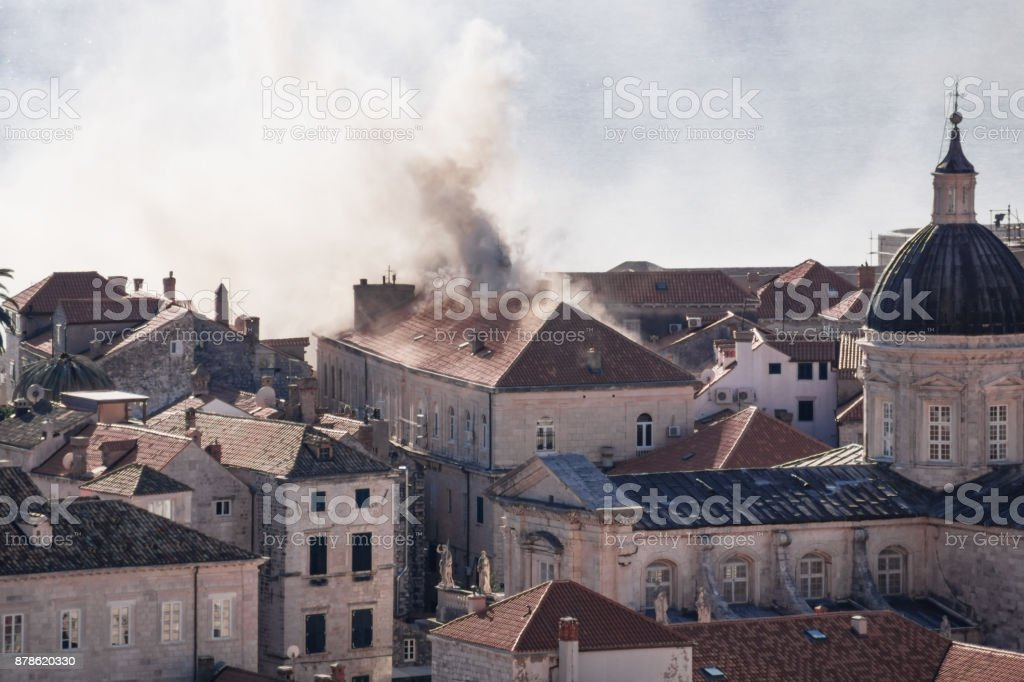 Smoking roof in Dubrovnik old town detail with churchtower, Croatia stock photo