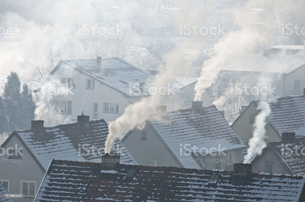Smoking roofs in winter stock photo