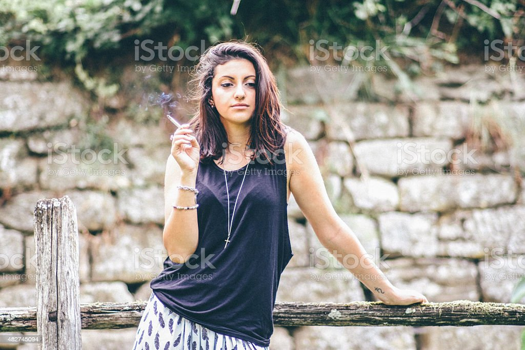 Smoking Sexy Teen In A Rural Scene Royalty Free Stock Photo