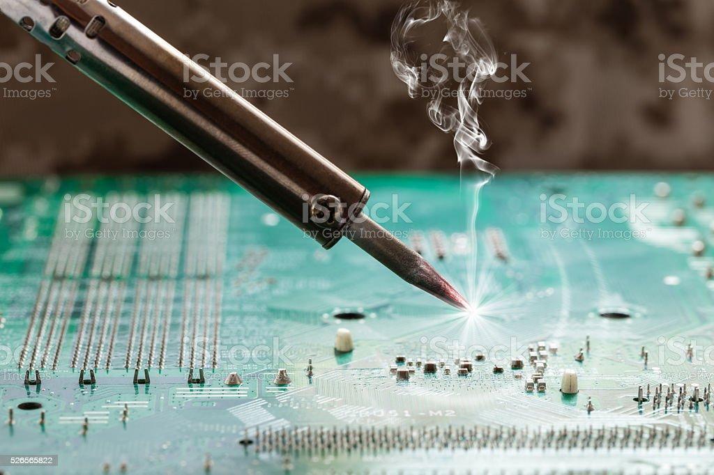 smoking soldering iron stock photo