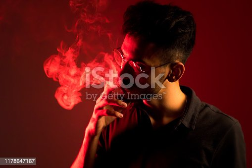 red and yellow gel lamps smoker man on red background