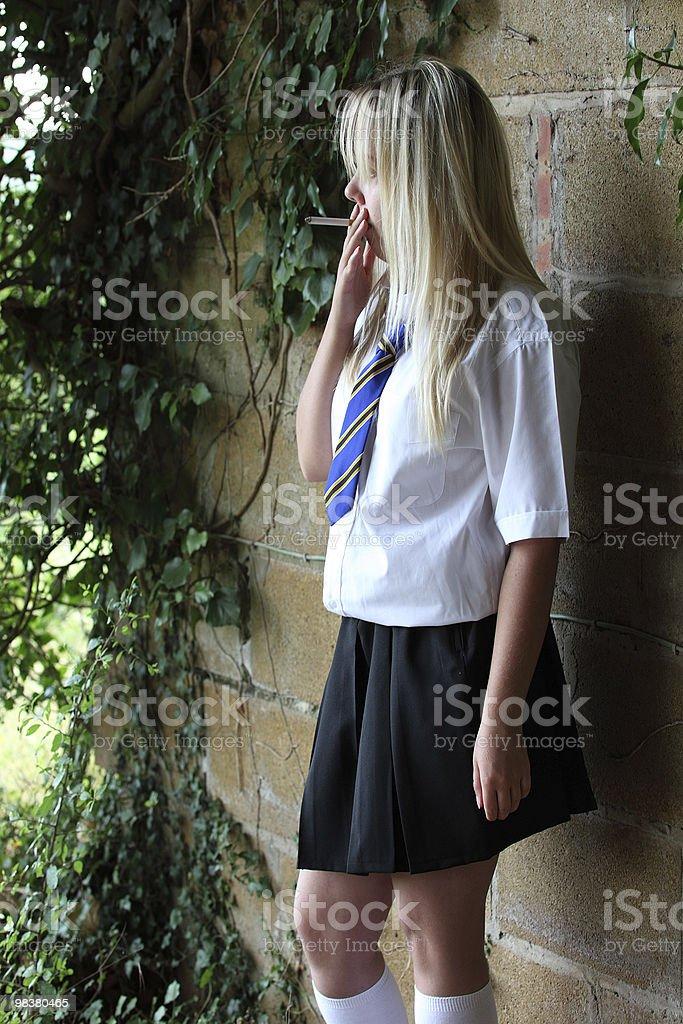 Smoking teenage schoolgirl royalty-free stock photo