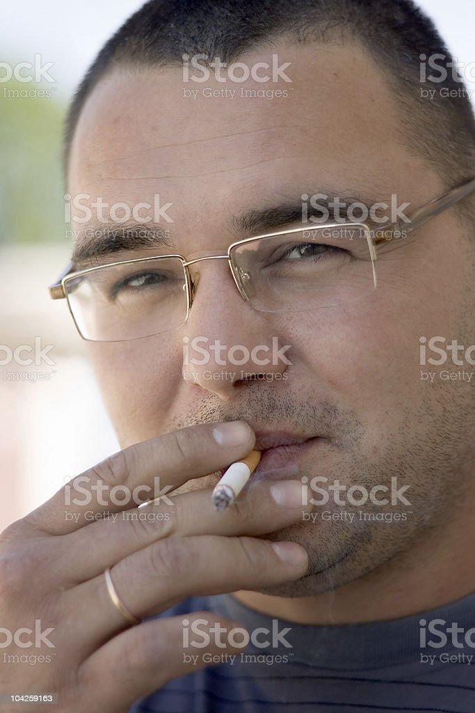 Smoking the man royalty-free stock photo