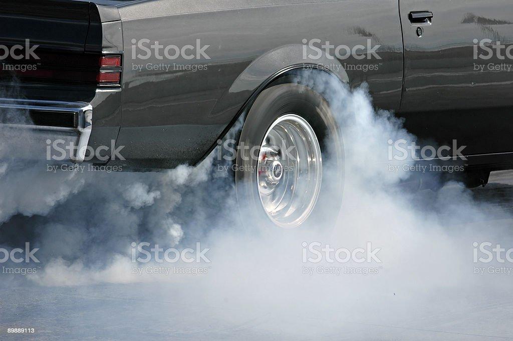 Smoking tire 2 stock photo