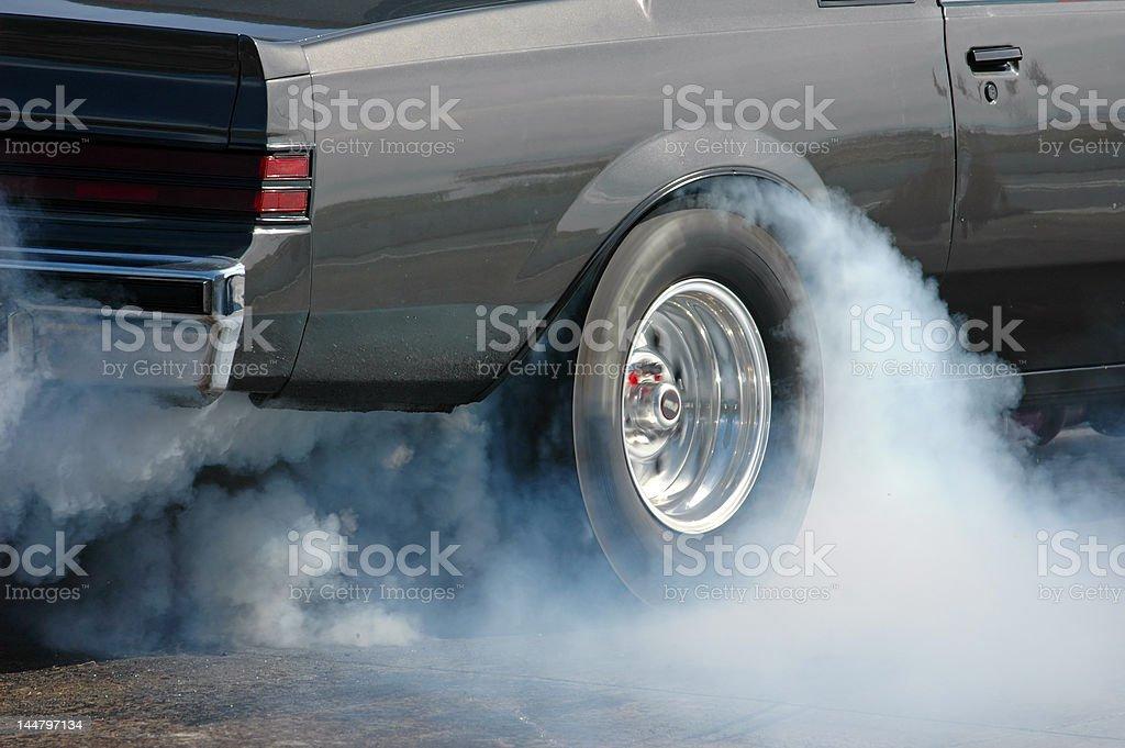 Smoking tire stock photo