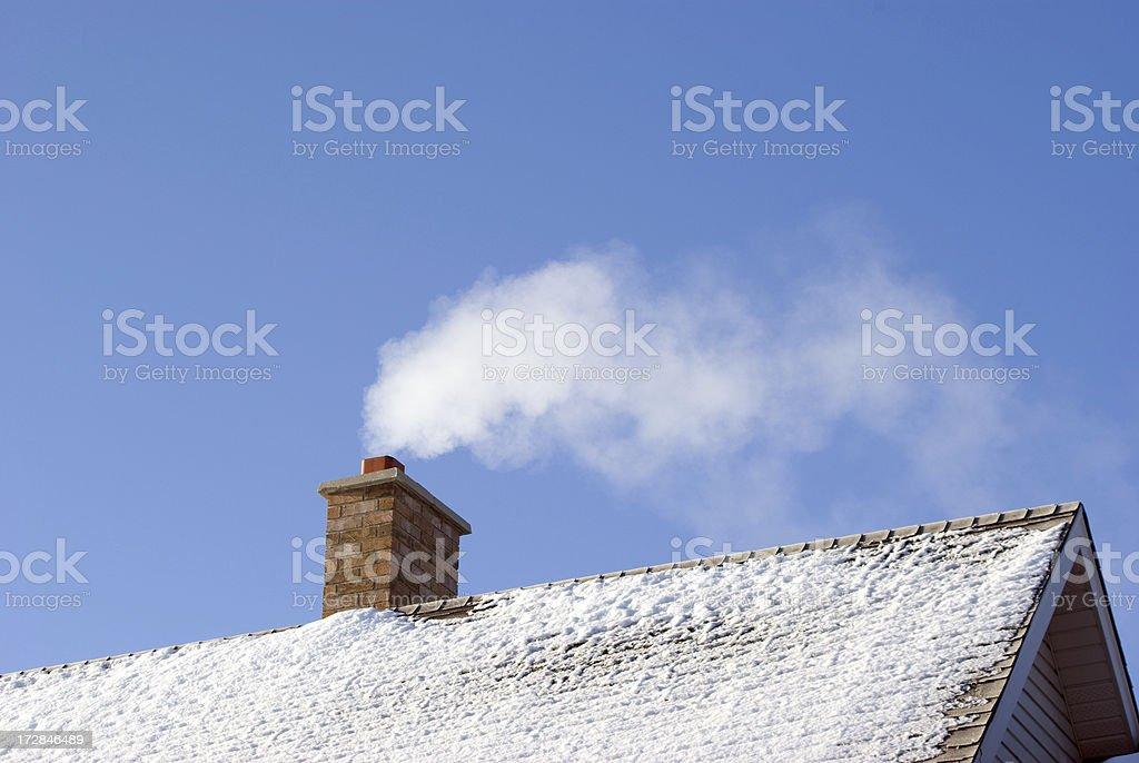 Smoking Winter Chimney stock photo