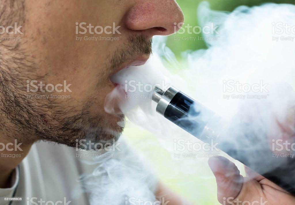 Smoking with vaporizer stock photo