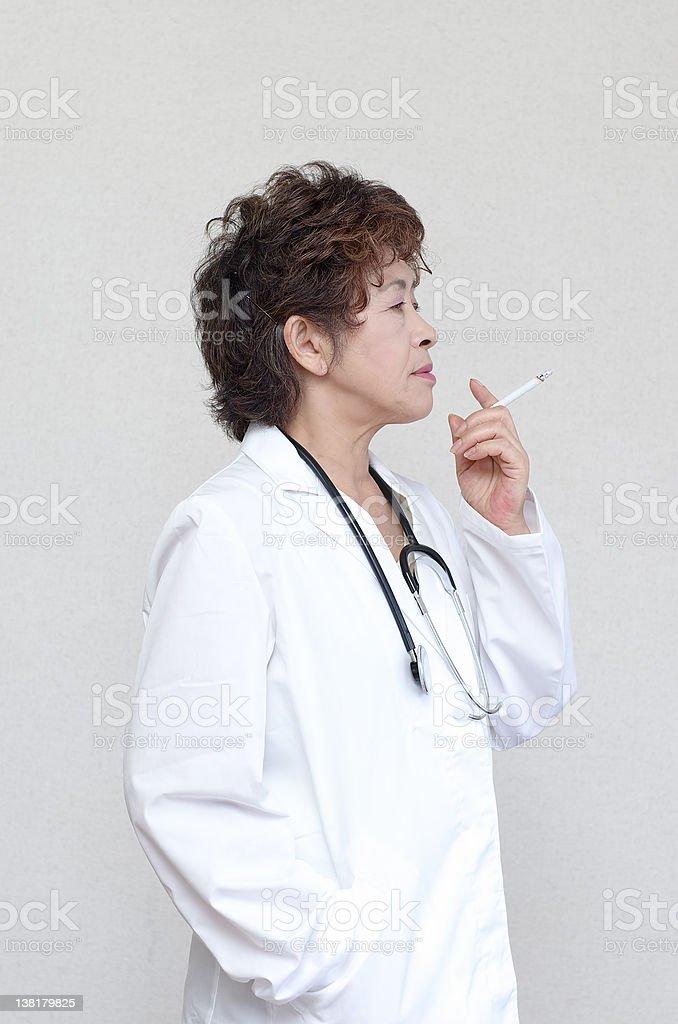 Smoking woman doctor stock photo